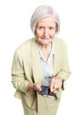 Senior woman holding mobile phone over white and looking at camera Royalty Free Stock Images