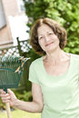 Senior woman holding rake Royalty Free Stock Photos