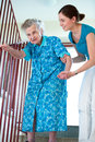 Senior woman with home caregiver women is climbing stairs Stock Image