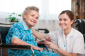 Senior woman with home caregiver women her at Stock Image