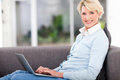 Senior woman home pretty at using laptop Royalty Free Stock Photos