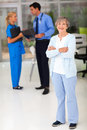 Senior woman hospital smiling women in with her doctor and nurse on background Royalty Free Stock Photography