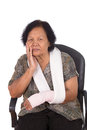 Senior woman with an injured arm wrapped in an Elastic Bandage Royalty Free Stock Photo