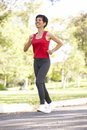 Senior Woman Jogging In Park Royalty Free Stock Photo