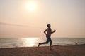 Senior woman jogging on sea beach Royalty Free Stock Photo