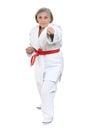 Senior woman in karate pose