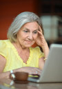 Senior woman with laptop sitting and coffee in hotel Royalty Free Stock Photos