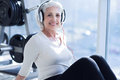 Senior woman listening to music at gym Royalty Free Stock Photo