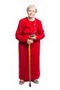 Senior woman listening to music over white background Royalty Free Stock Photos
