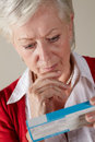 Senior woman looking at prescription drug pack Royalty Free Stock Photos