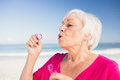 Senior woman making bubbles with a bubble wand Royalty Free Stock Photo