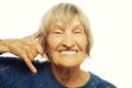 Senior woman is making a call me gesture happy Stock Photo
