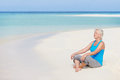 Senior woman meditating beautiful beach happy Stock Image