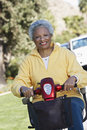 Senior Woman On Motor Scooter Stock Image