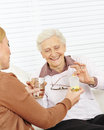 Senior woman in nursing home taking women medical pills with water Stock Photos