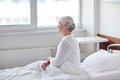 Senior woman patient lying in bed at hospital ward Royalty Free Stock Photo