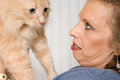 Senior woman with pet cat Royalty Free Stock Photo