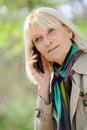 Senior woman phoning happy outdoor Royalty Free Stock Image