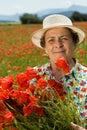 Senior Woman Picking Flowers O...