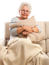 Senior woman with pillow and blanket portrait of resting at home in hands on feet isolated on white background Stock Images