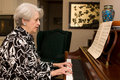 Senior Woman Playing Piano Stock Photos