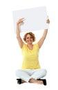 Senior woman pointing at blank ad board