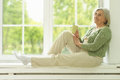 Senior woman portrait with cup of tea