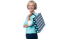 Senior woman posing with shopping bag stylish old holding polka Royalty Free Stock Image