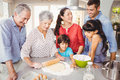 Senior woman preparing food with family women happy at home Stock Images