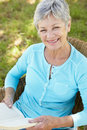 Senior woman reading a book Royalty Free Stock Photography