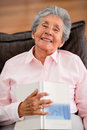 Senior woman reading a book lovely at home Stock Image