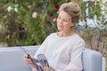 Senior woman reading magazine Royalty Free Stock Photo
