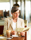 Senior woman reading  menu card in cafe Stock Photography