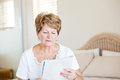 Senior woman reading newspaper Stock Photo