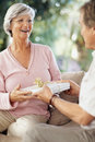 Senior woman recieving gift  from a man Royalty Free Stock Photography