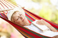 Senior Woman Relaxing In Hammock Royalty Free Stock Photos