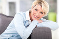 Senior woman relaxing pretty on a couch at home Royalty Free Stock Images