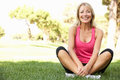 Senior Woman Resting After Exercising In Park Royalty Free Stock Photo