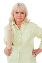 Senior woman with rolling pin angry holding and looking at camera while standing isolated on white background Stock Image