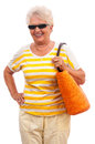 Senior woman with shopping bag very happy old in vivid colored clothes orange sun glasses laughing having fun isolated on white Stock Photography