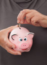 Senior woman showing a piggy bank hand Stock Images