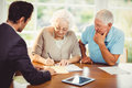 Senior woman signing document Royalty Free Stock Photo