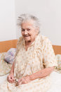Senior woman sitting in bed Stock Photography