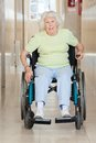 Senior woman sitting in a wheel chair full length portrait of Stock Image