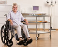 Senior woman sitting in wheelchair Stock Photos