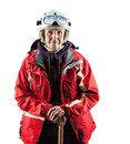 Senior woman in ski jacket and helmet over white with clipping path Stock Photos