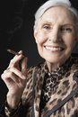 Senior Woman Smoking Cigarillo Royalty Free Stock Photo