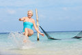Senior woman splashing in beautiful tropical sea having fun Stock Photos