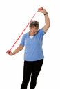 Senior woman stretching exercising with rubber band isolated Stock Photo