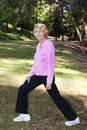 Senior woman stretching in park Royalty Free Stock Photo